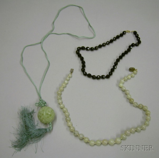 Strand of Jade Beads, Carved Jade Ball Pendant, and a Black Jet Beaded Necklace.
