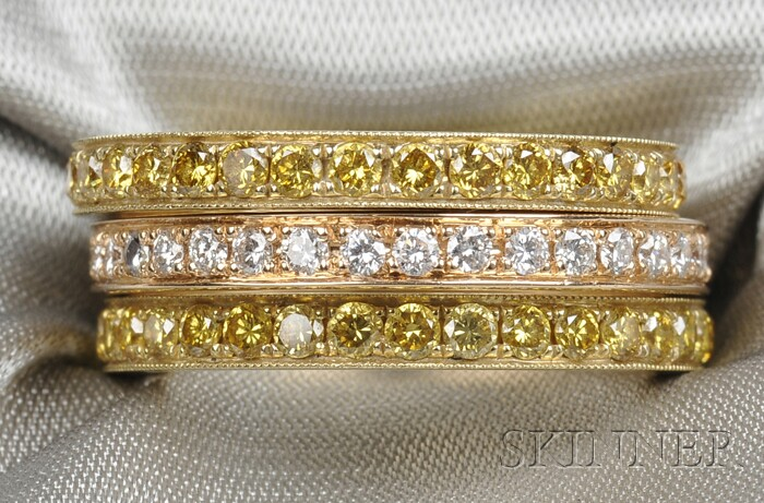 Three 18kt Gold, Yellow Diamond, and Diamond Bands