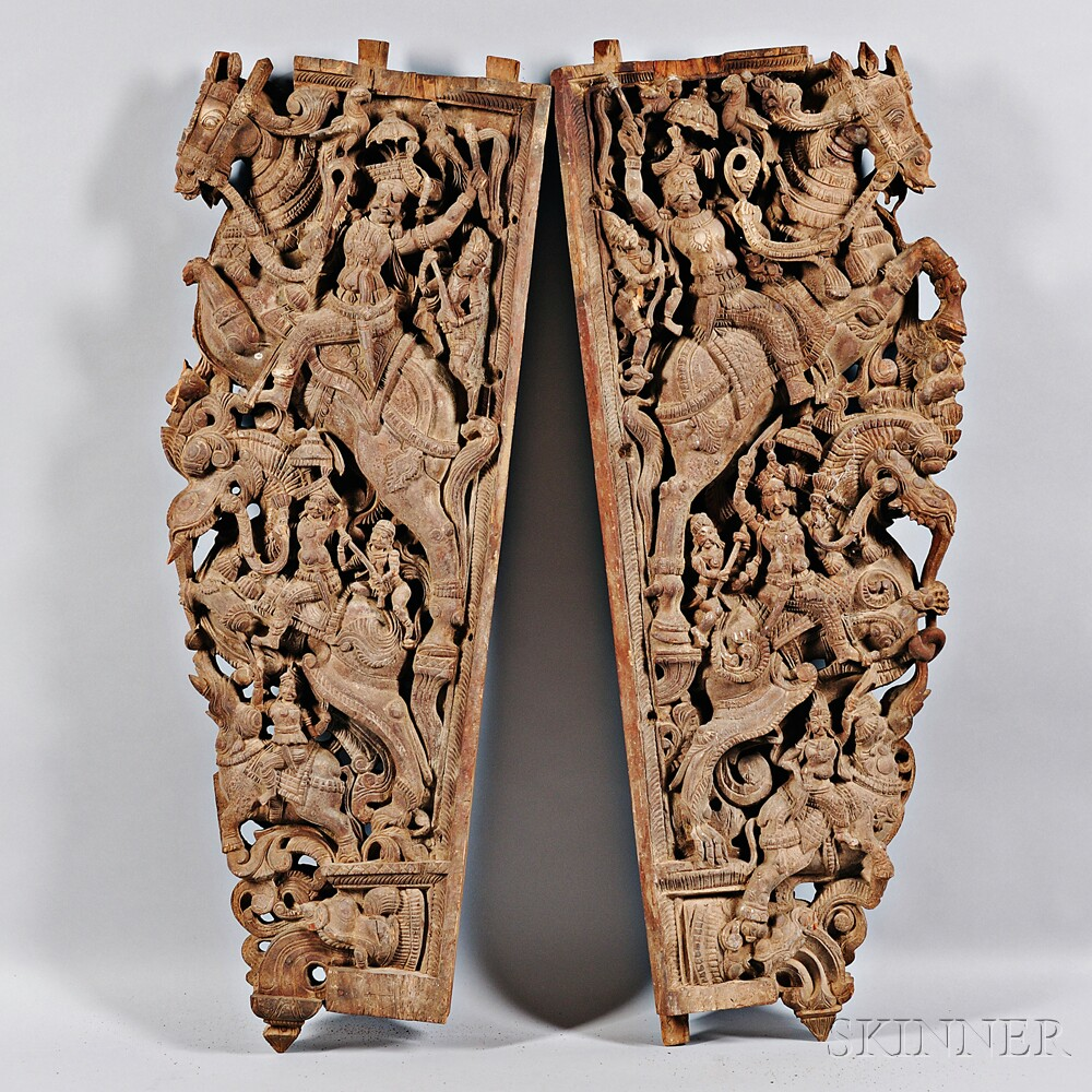 Two Carved Wooden Doorframe Brackets