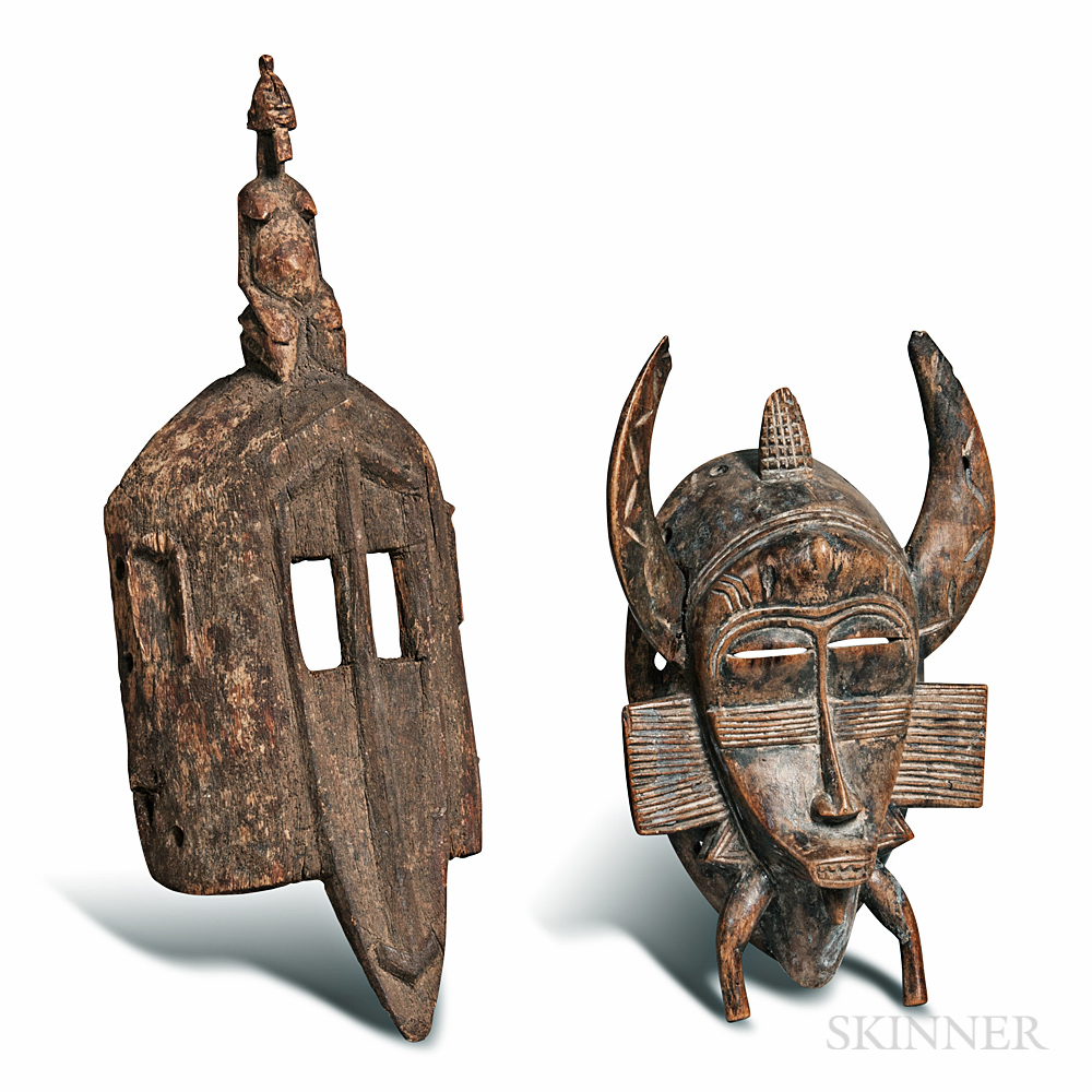 Senufo-style and a Dogon-style Carved Masks