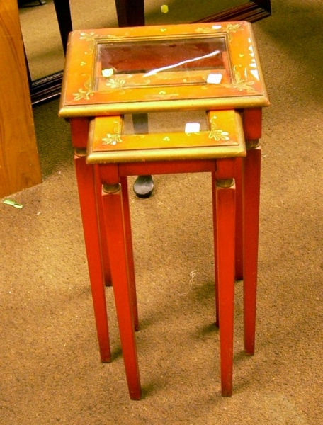 Two Nesting Glass-inset Top Red-painted and Decorated Wooden Stands.