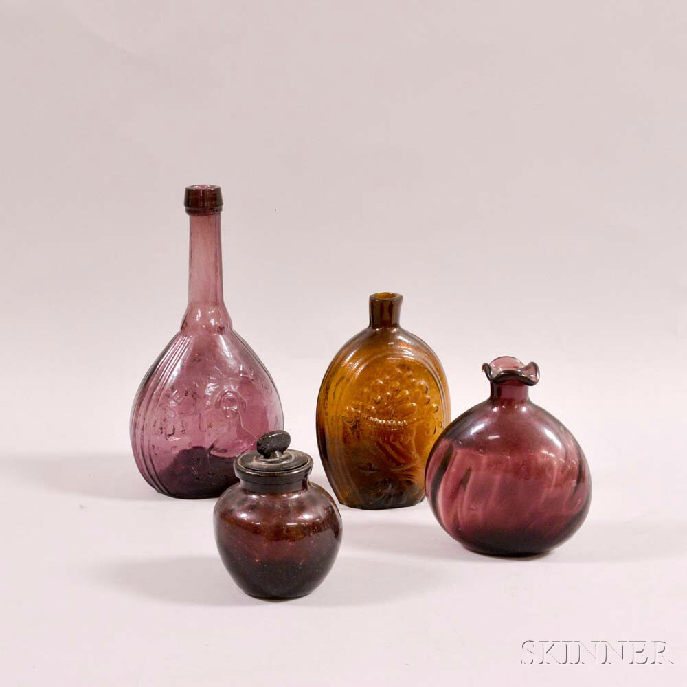 Four Colored Glass Bottles and Flasks