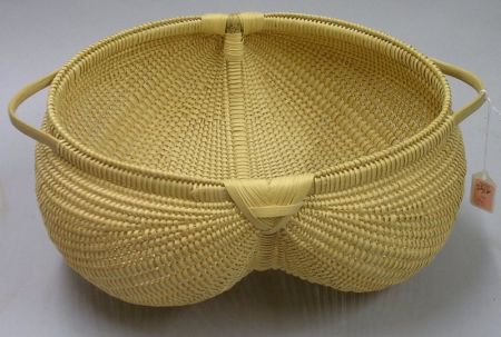 Modern Woven Two-Handled Buttocks Basket.