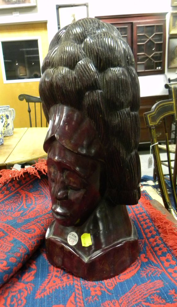 Carved and Stained Hardwood Sculpture of a Female Bust