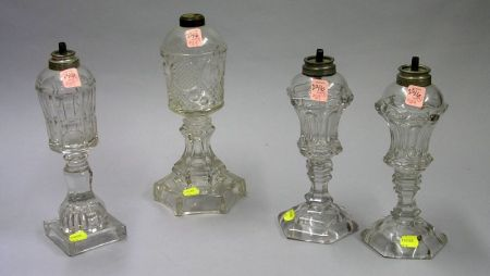 Four Colorless Pressed Glass Whale Oil Lamps