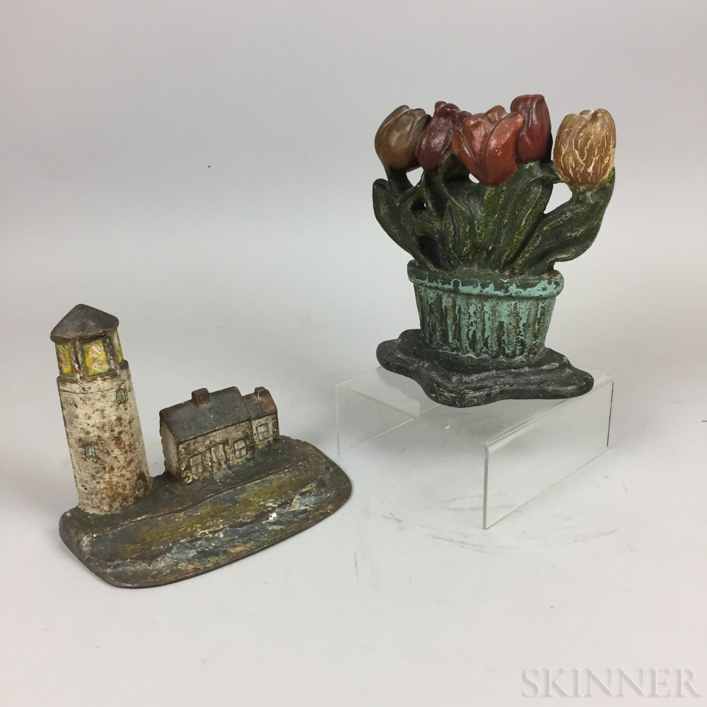 Two Polychrome Cast Iron Doorstops