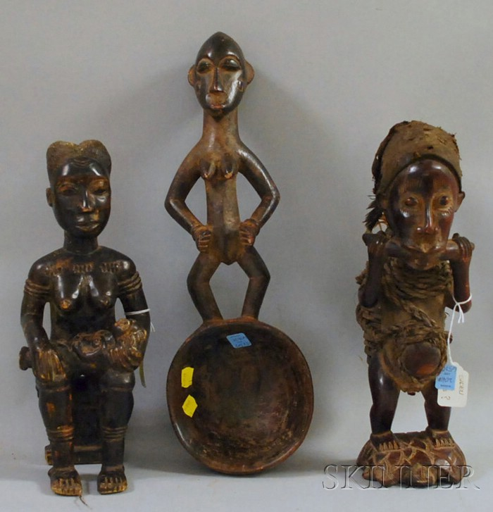 Two African Carved Wooden Standing Figures and a Figural Spoon