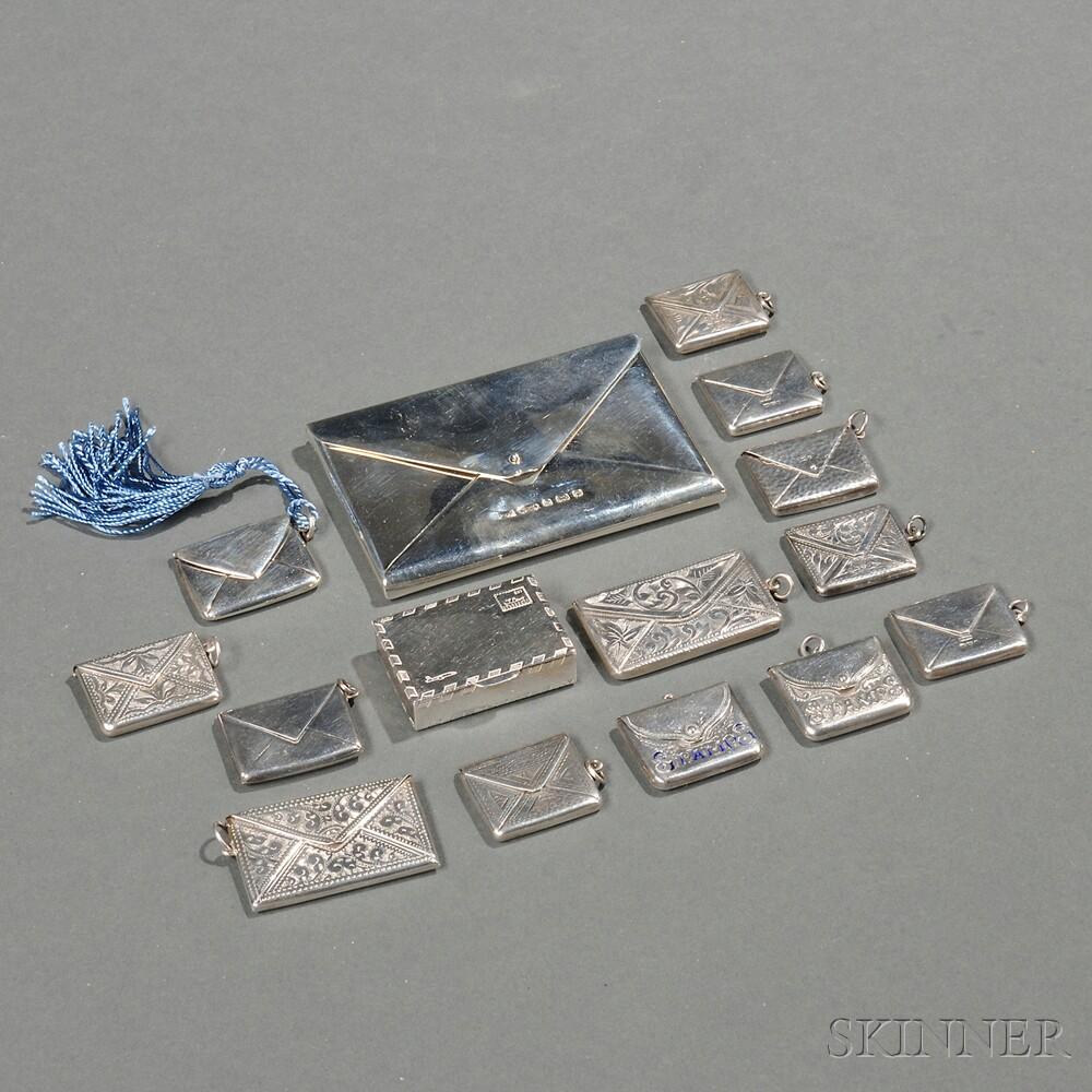 Fourteen Envelope-form Sterling Silver Stamp Boxes