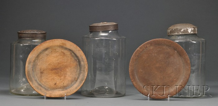 Three Blown Glass Storage Jars and Two Wooden Trenchers