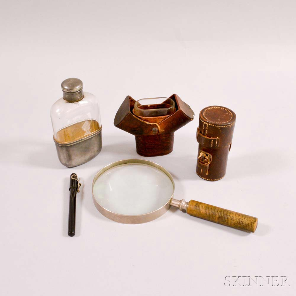 Leather Flask, a Cased Magnifier, a Glass Flask, and a Magnifying Glass.     Estimate $50-75