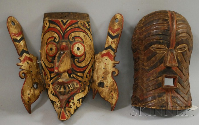 Carved Wood African Mask and Polychrome Wood Indonesian Mask