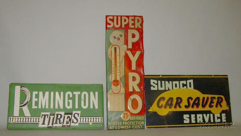 Remington Tires, Sunoco Car Service, and Super Pyro Antifreeze Signs
