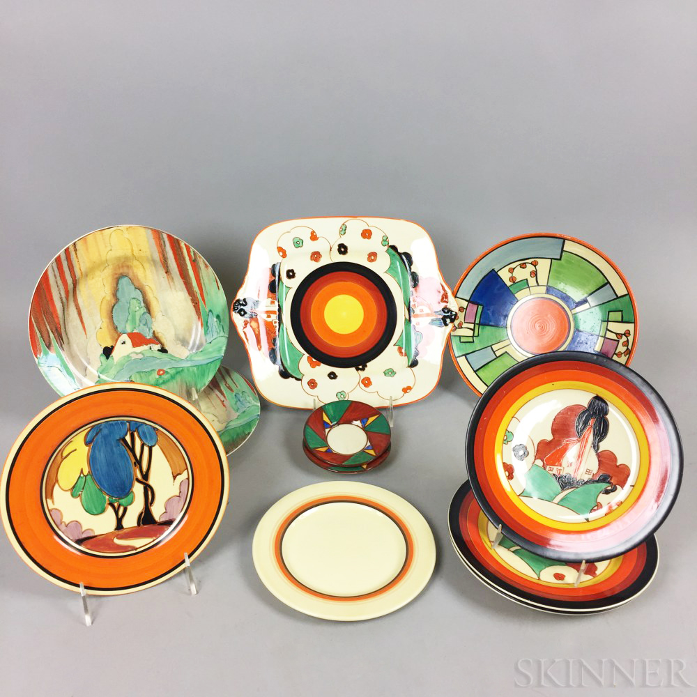 Twelve Clarice Cliff-decorated Newport Pottery Plates and Dishes