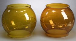 Pair of General Electric Etched Amber Glass Globes.