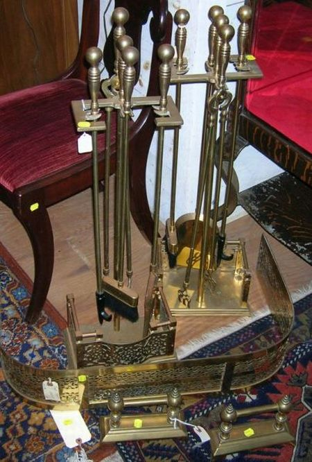 Pair of Brass Fire Tool Stands with Four Tools, a Brass Fireplace Fender, and a Pair of Tool Rests.