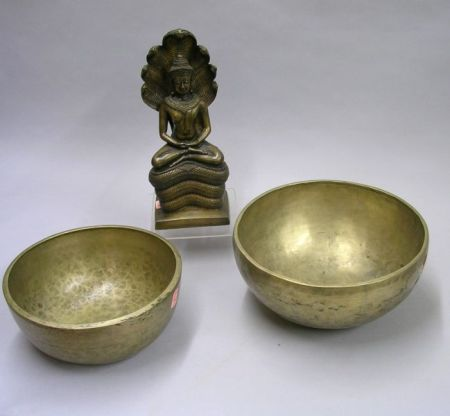 Two Asian Hammered Brass Singing Bowls and a Bronze Figure of Deity.