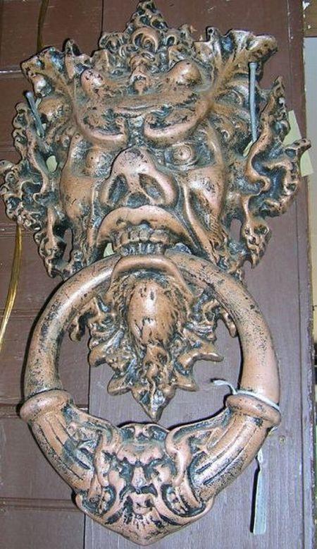 Painted Cast Metal Grotesque Mask Doorknocker.