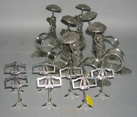 Set of Six Kate Greenaway Style Silver Plated Figural Napkin Rings and a Set of Seven Silver Plated Music Stand-form Placecard Ho...