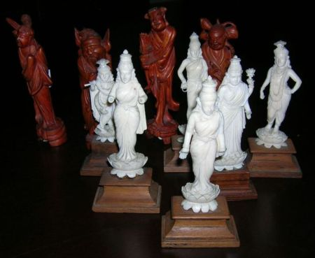 Six Indian Carved Ivory Deity Figures and Four Chinese Carved Hardwood Sage Figures