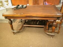 Renaissance Revival Walnut Extension Dining Table with Lion Masques.