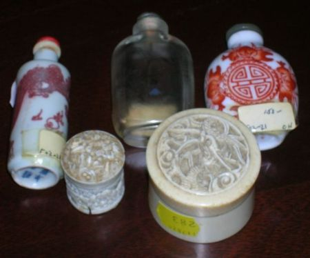 Three Asian Glass and Porcelain Snuff Bottles and Two Small Chinese Carved Ivory Boxes.