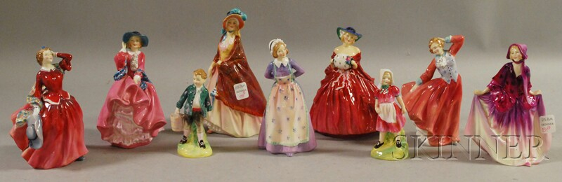 Nine Royal Doulton Porcelain Figures
