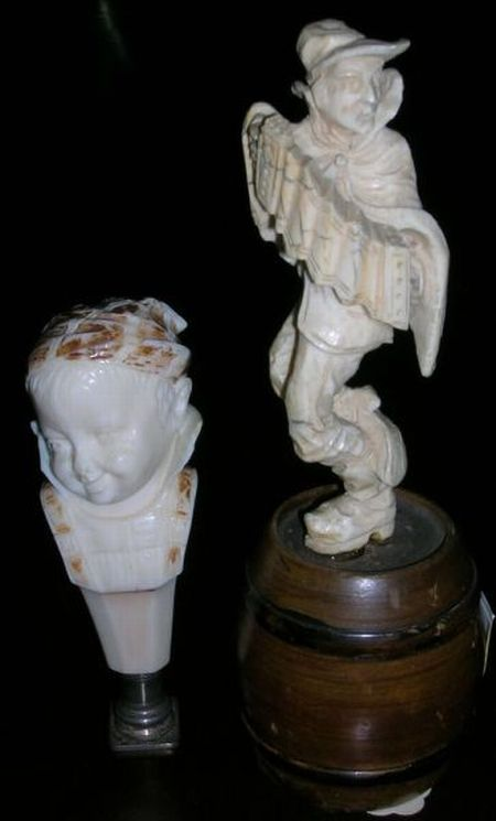 19th Century Carved Ivory Seal and a German Carved Ivory Accordion Player on Cask Figural.