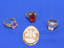 Three Gold and Gemstone Rings and a Cameo Pendant.