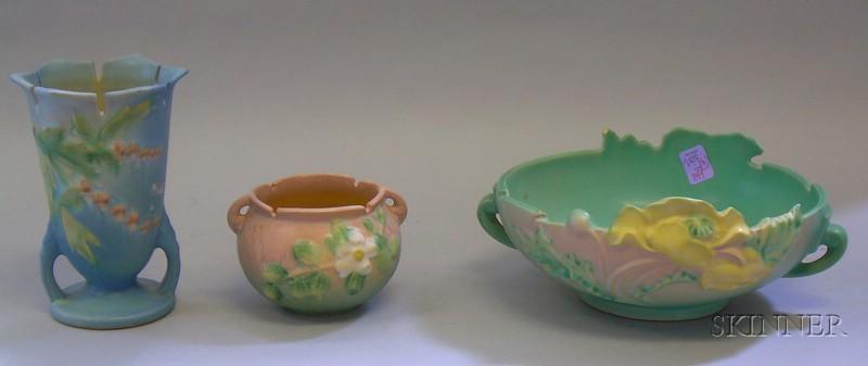 Roseville Pottery Poppy Low Bowl, Bleeding Heart Vase, and White Rose Bowl.