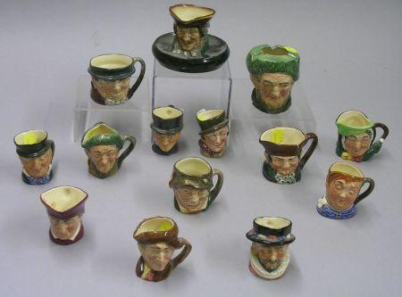 Twelve Miniature Royal Doulton Character Jugs, an Ashpot, and a Matchholder