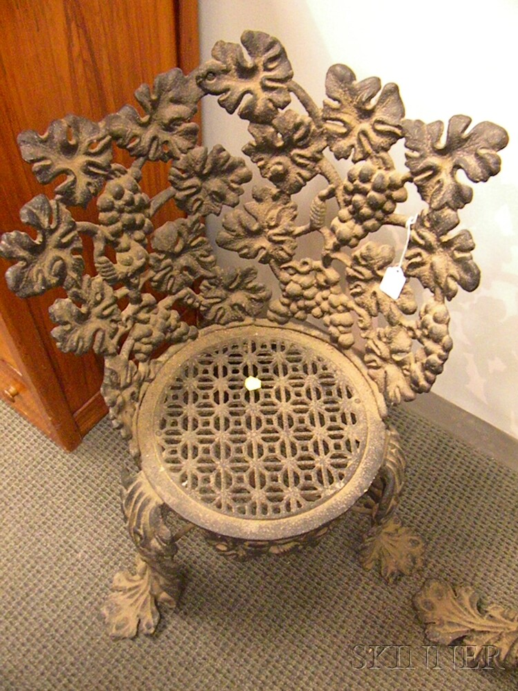 Pair of Black-painted Cast Iron Grapevine Pattern Garden Chairs.     Estimate $300-500