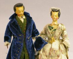 Unusual Early Wooden Man and Woman Dolls