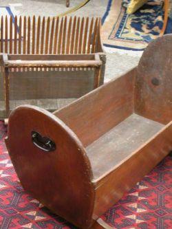 Pine Open Cradle and Wooden Cranberry Scoop.