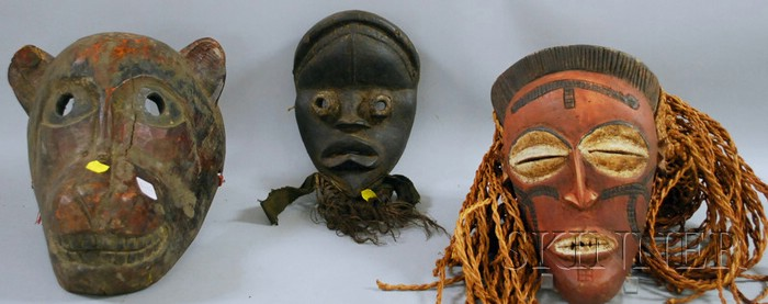 Two African-style Masks and One Himalayan Mask.