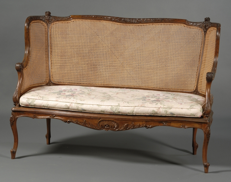 Louis XV Style Carved Walnut and Caned Settee