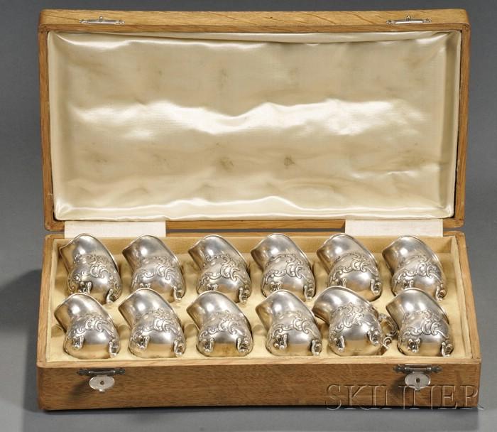 Boxed Set of Twelve Czechoslovakian .800 Silver Individual Creamers