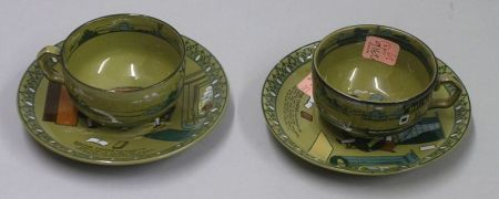 """Two Buffalo Pottery Emerald Deldare Ware """"Dr. Syntax and Bookseller"""" Saucers and a   Pair of Deldare Ware Cups"""