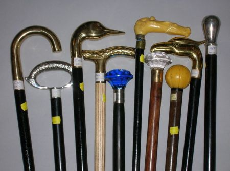 Collection of Ten Modern Ebonized Wood Canes and Walking Sticks