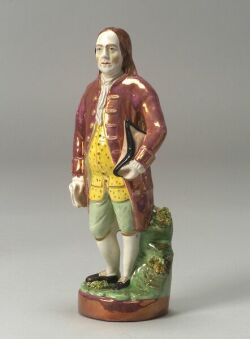 Polychrome Enamel and Pink Lustre Staffordshire Pottery Figure of Benjamin Franklin