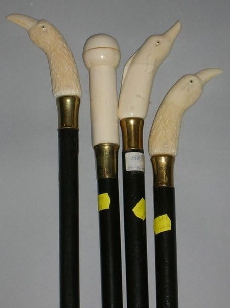Four Modern Ebonized Wooden Walking Sticks with Carved Ivory Figural Handles
