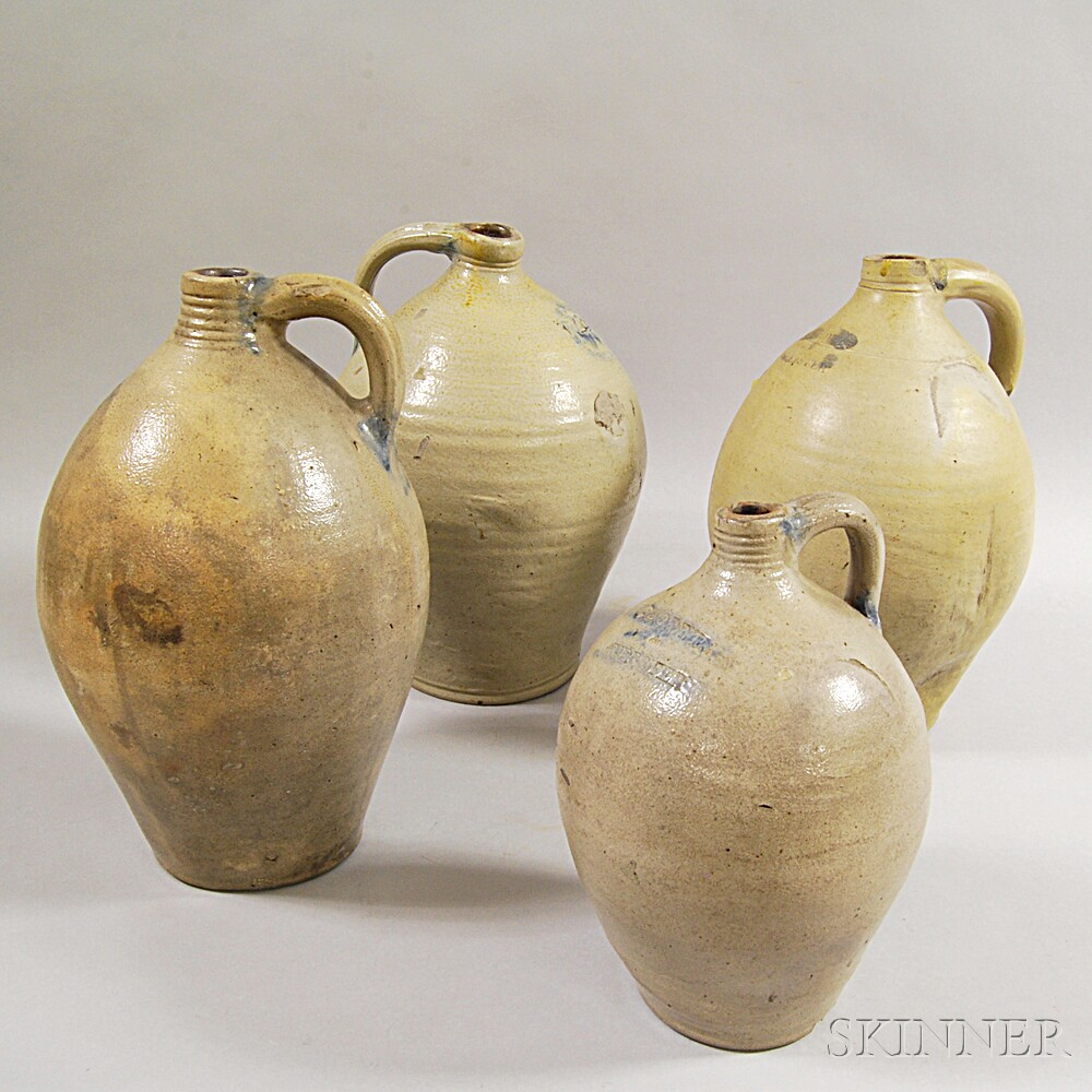 Four Early New England Stoneware Jugs