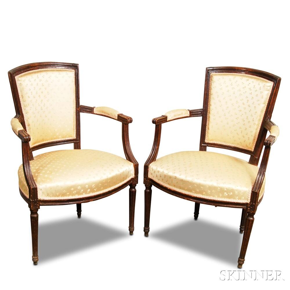 Pair of Louis XVI Carved Beechwood Upholstered FauteuilPair of Louis XVI...
