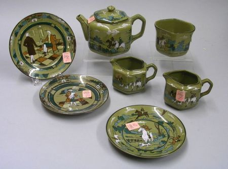 "Four-Piece 1908 Buffalo Pottery Deldare Ware ""Breaking Cover"" Tea Set and Three Assorted   Saucers"