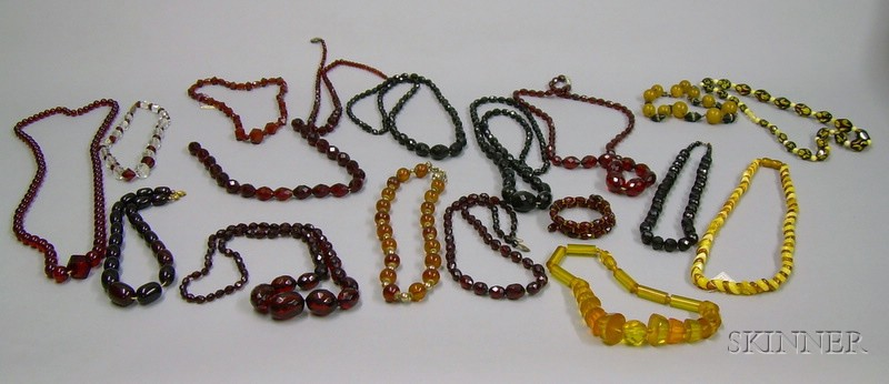 Eighteen Art Deco and Later Amber and Amber-type Necklaces.
