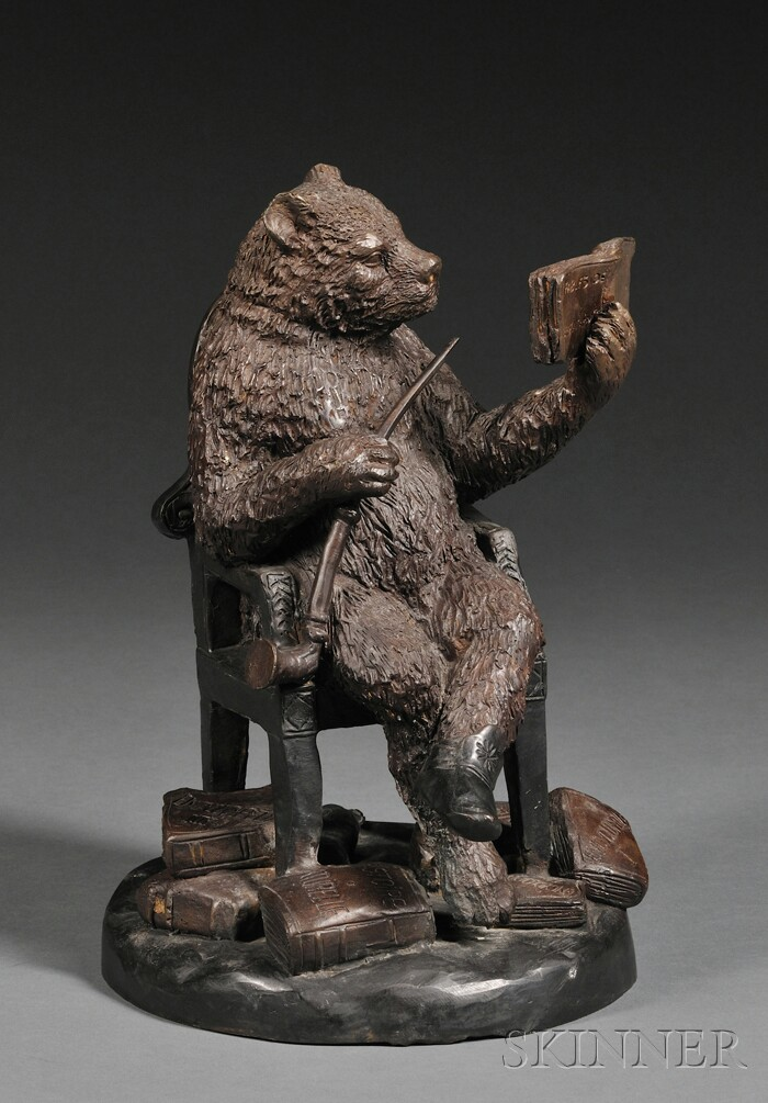 Whimsical Patinated Bronze Figure of a Bear Reading a Book