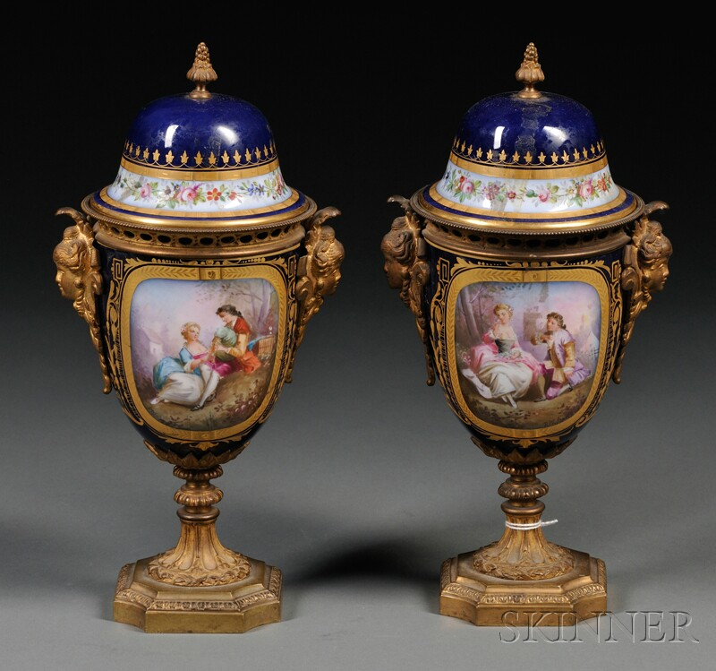 Pair of Bronze-mounted Sevres-style Cobalt Blue Porcelain Covered Urns