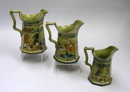 Three 1908 Buffalo Pottery Graduated Deldare Ware Pitchers