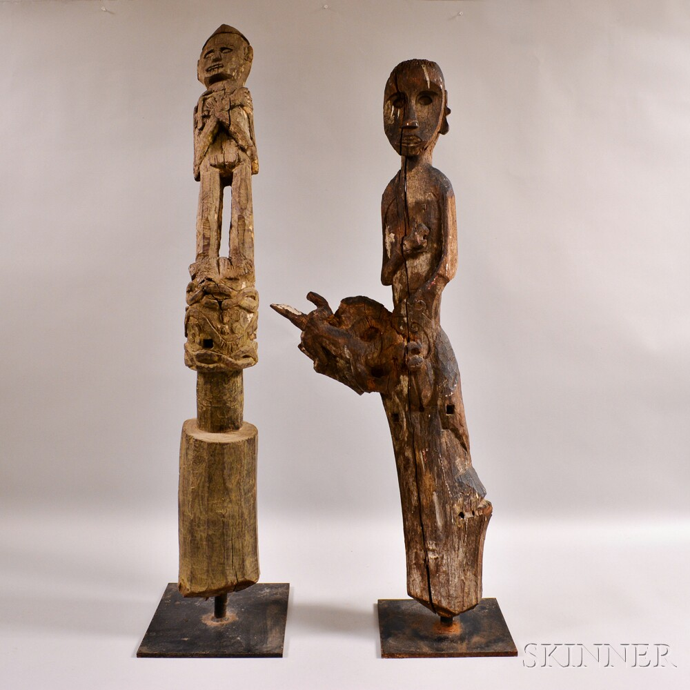 Two Large Carved Wood Grave Posts