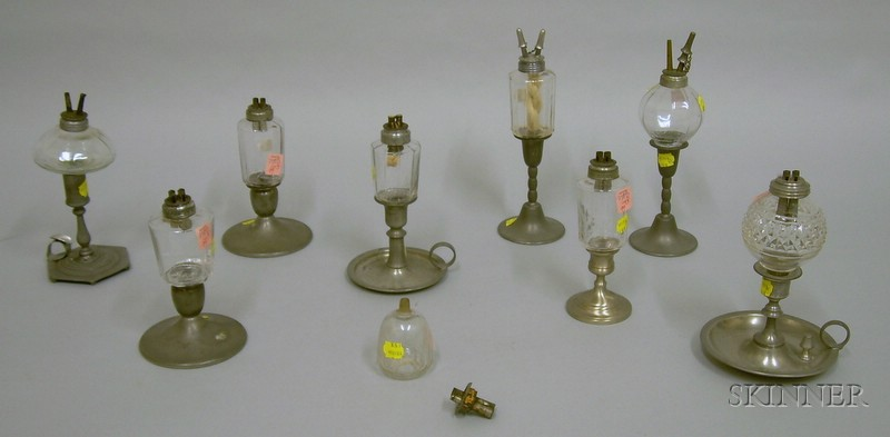 Nine Colorless Glass Peg Lamps on Pewter Candlestick Bases.