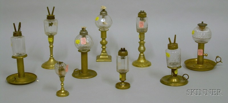 Nine Colorless Glass Peg Lamps on Brass Candlestick Bases